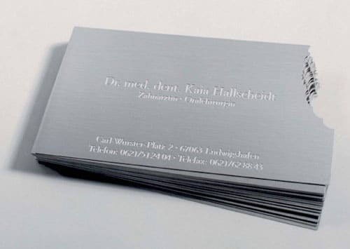 A business card for a dentist, made of metal and a corner bitten off. Not sure how cost effective it is but definitely eye catching.